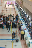 Passenger queue near check-in desks in airport Royalty Free Stock Photos