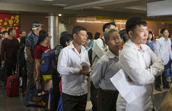 Passenger queuing in line at check-in counter in Noi Bai International Airport Stock Image