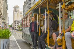 Passenger riding on a famous San Francisco cable car Royalty Free Stock Photo