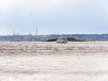 Passenger river ship on the horizon. Russia, Saratov, the Volga river. Smokestacks in the background Royalty Free Stock Photos