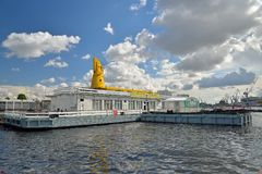Passenger river terminal under the blue sky with the Lieutenant Royalty Free Stock Photos