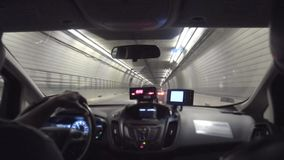 Passenger`s Backseat View Inside a Taxi in a Boston Tunnel. 7142 A passenger`s view riding in a taxi through a tunnel under Boston stock footage