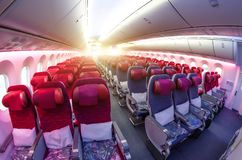 Passenger seat, Interior of airplane with passengers sitting on seats. Royalty Free Stock Image