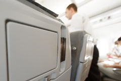 Passenger seat of plane with screen. Royalty Free Stock Photos