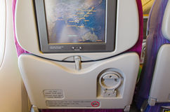 Passenger seat of plane with screen map Royalty Free Stock Image