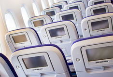 Passenger seat of plane with screen Royalty Free Stock Photography