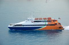 Passenger service boat connecting two ports. Fast water transportation ship in Cozumel, Mexico Royalty Free Stock Image