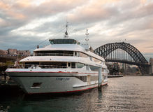 Passenger ship is anchored at the Circular Quay. Sydney, Australia - July 12, 2010 : Passenger ship is anchored at the Circular Quay in Sydney. Harbour Bridge on stock photo