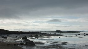 Passenger Ship Anchoring at evening near Edgeoya, Svalbard Stock Images