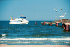 Passenger ship approaches a pier in Rugen island, toned image Stock Image