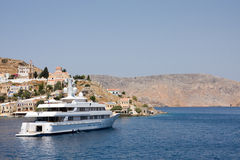 Passenger ship in bay of symi island Royalty Free Stock Photo