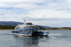 Passenger ship in the Beagle channel shore estates Harberton. Stock Images