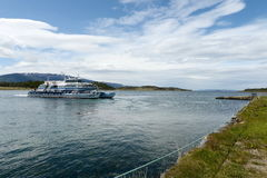 Passenger ship in the Beagle channel shore estates Harberton. royalty free stock images