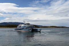 Passenger ship in the Beagle channel shore estates Harberton. Stock Photo