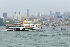 Passenger ship in Bosphorus, Istanbul. Passenger ship Baris Manco on the way across the Bosphorus on the background of Beyoglu district of Istanbul, Turkey. The Stock Photo