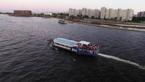 Passenger ship in a city river stock video