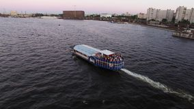Passenger ship in a city river. At the evening stock video footage