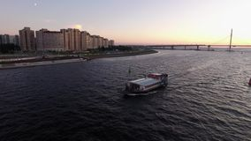 Passenger ship in a city river. At the evening stock video