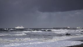 Passenger ship entering in the harboe during storm Stock Image