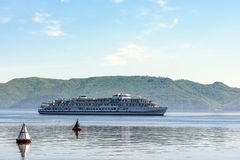 Passenger ship floats past the mountains. Navigation equipment for waterways stock photography
