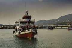 Passenger ship in front of the harbor docks of the island of Koh Samui Thailand. Typical passenger boat on the island of Koh Samui in the gulf of Thailand royalty free stock photos