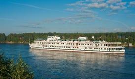 Passenger ship going down the river. Passenger ship goes down the river on a summer day Stock Photo