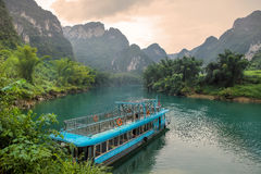 Passenger ship in Hechi Small Three Gorges,Guangxi,China. Hechi Small Three Gorges is a Karst gorge,located in Hechi,Guangxi province,China Stock Photos