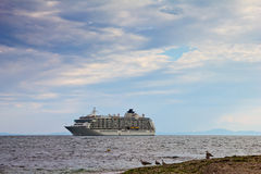 Passenger ship near to the beach. Cruise liner near to the beach in Nessebar Bulgaria Royalty Free Stock Images