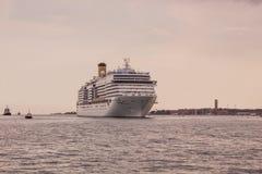 Passenger ship near Venice. Italy. Touristic, travel. Large passenger ship on the sea near Venice, Italy .Dramatic sky Stock Photo