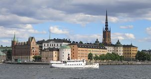 Passenger ship passes by buildings of Old Town in Stockholm stock footage