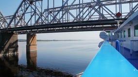 Passenger ship passes under the railway bridge. stock video footage