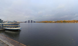 Passenger ship at the pier and a panoramic view of the Dnieper. Stock Photos