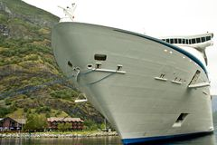 Luxury cruise ship docked in port Flom, Norway. Passenger ship in port Flam, Norway. Luxury cruise ship docked in port Flom, Norway. Front view of liner ship Royalty Free Stock Image