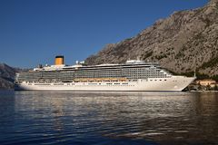 Passenger ship in the port. Large passenger ship in the port of Kotor, Montenegro. Kotor is World Heritage City and one of the major tourist destinations in stock photo