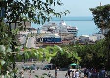 Passenger ship in the port of Odessa, Ukraine. Odessa, Ukraine - July 22, 2012: People descending to the port where the passenger ship is moored. The port of royalty free stock image