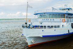 Passenger ship is on a river. Big passenger ship is on a river royalty free stock photos
