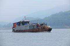 Passenger ship running on Song Da hydro-power lake Royalty Free Stock Image
