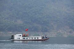 Passenger ship running on Song Da hydro-power lake Stock Photo
