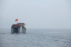 Passenger ship running on Song Da hydro-power lake Stock Image