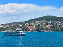Passenger ship sails around the island Heybeliada. Stock Image