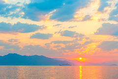 Passenger ship on the sea and. A beautiful sunrise royalty free stock photos