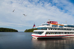 Passenger ship standing at the pier on the island of Valaam Stock Photos