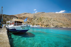 Passenger ship staying near pier of Loutro town on Crete island Stock Images