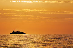 Passenger ship at sunset Royalty Free Stock Images