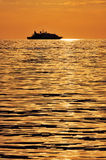 Passenger ship at sunset Stock Images