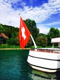 Passenger ship and swiss flag in Thun lake Royalty Free Stock Images