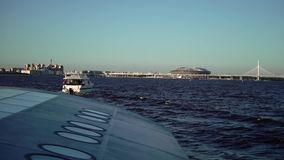 Passenger ship and yacht in a city river stock video
