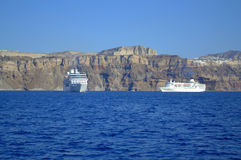 Passenger ships at Caldera,Santorini. This azure blue sea and sky and the dazzling white houses were things that most impressed me in Santorini.Villages are Royalty Free Stock Photo
