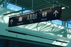Passenger signage in Portland airport terminal. Baggage claim, gates, and restroom directions and signage in Portland International Airport, Portland, Oregon Stock Images
