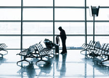 Passenger silhouette in the airport Royalty Free Stock Photo